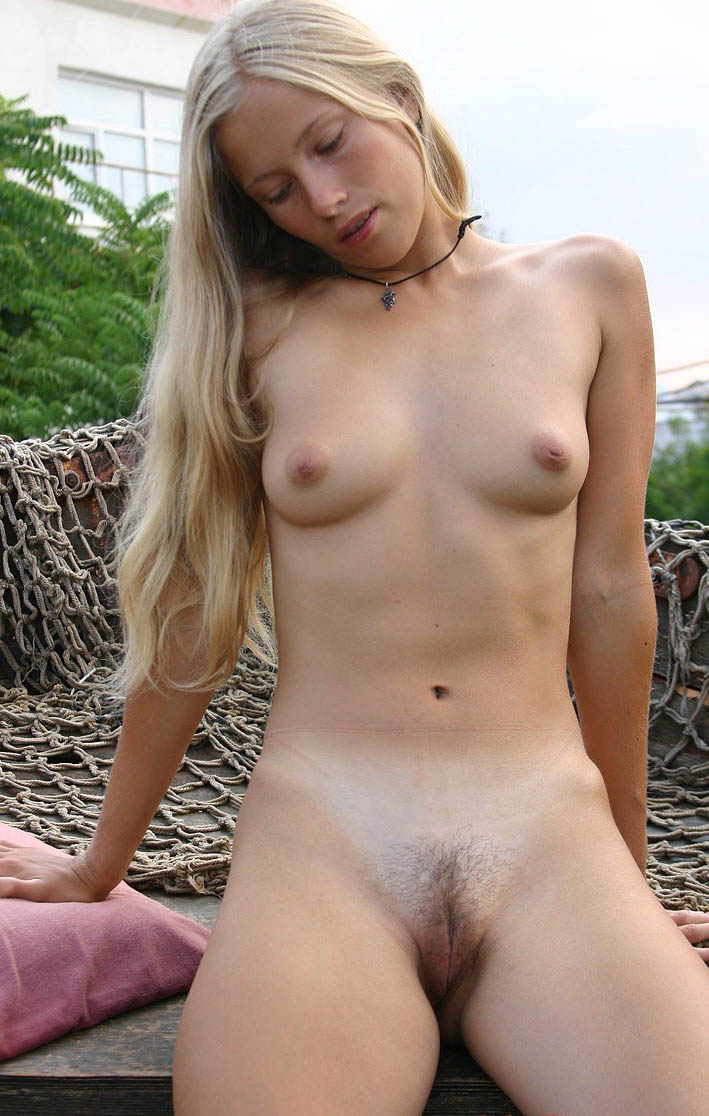 Cute tranny with puffy nipples masturbating
