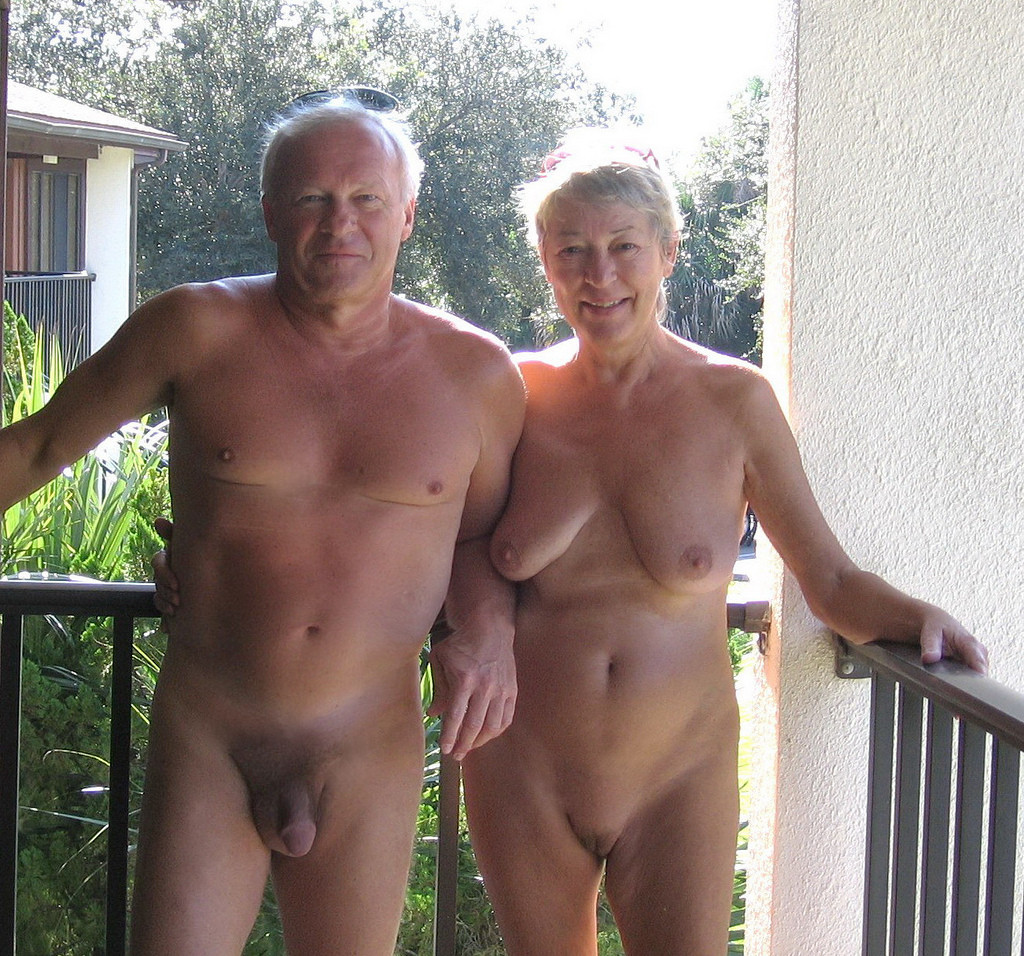 Old couple nudist smile and
