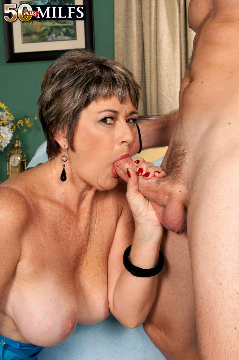 Mature lady with big tits gives her shaved pussy a treat 10