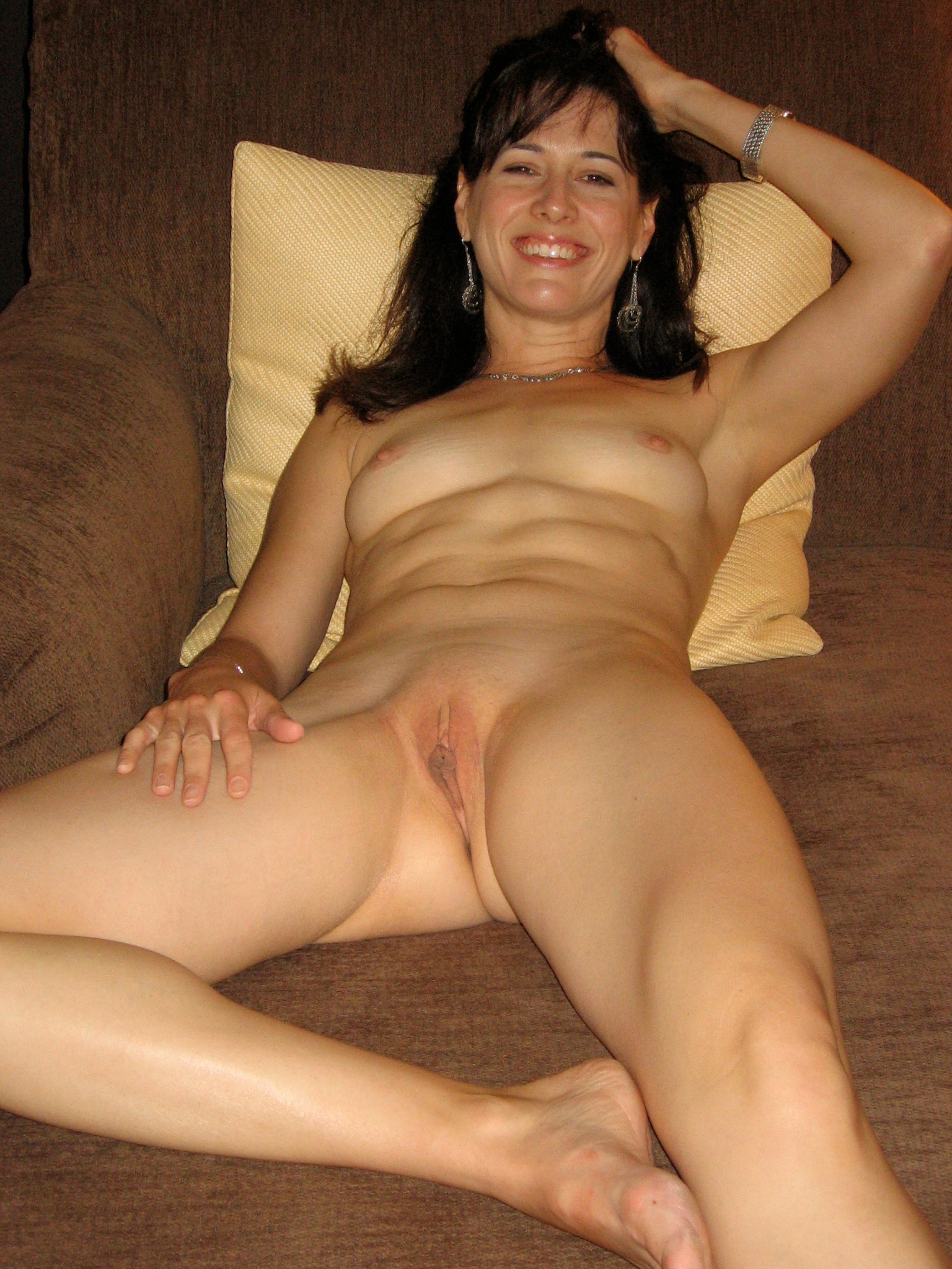 Mature legs spread on bed tied
