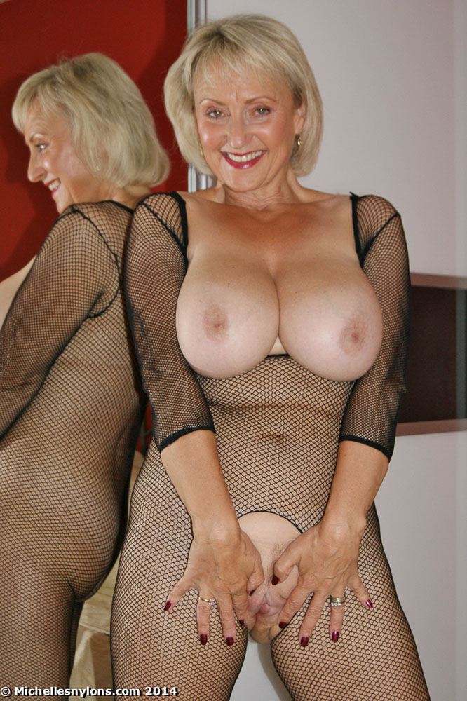 Blonde stripping in fishnet stockings and garter belt