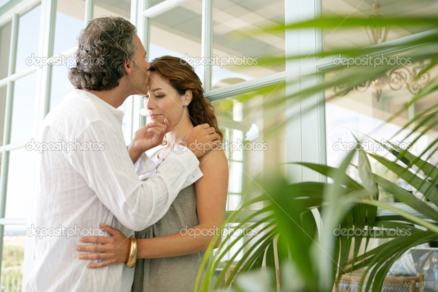 mature close up mature couple large photo home close kissing depositphotos standing glass stock doors