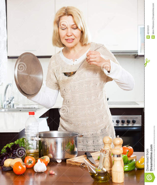 mature housewives photos mature home housewife kitchen happy housewives soup pan cooking interior ladle