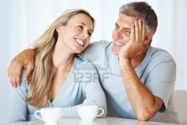 mature photos mature couple love photo having cup tea together logos portrait indoors