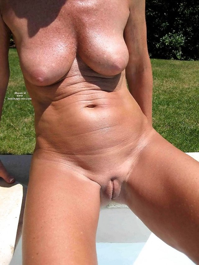 Mature nude woman beach