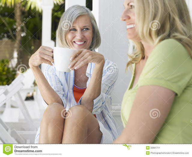 middle aged women porn pictures women young sitting cup happy vacation middle portrait stock aged coffee verandah