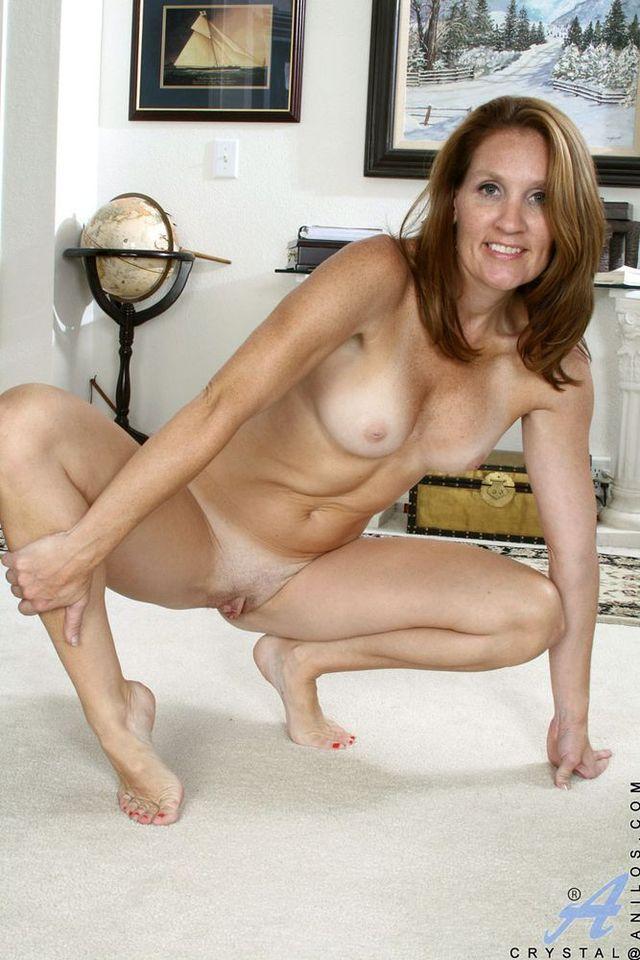 Blonde girl naked on bed