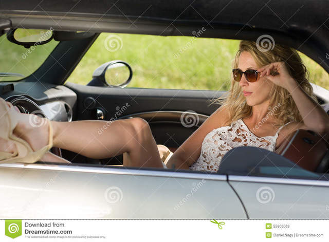 milf woman photo photos woman open milf legs beautiful sexy white showing dress summer time car sits sunglasses
