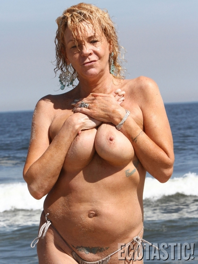 Essence. mature topless beach photo