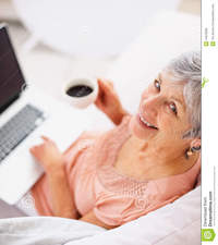 free older pic porn woman happy old woman drinking coffee using laptop royalty free stock