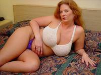 mature porn redhead busty plus size amateur mature redhead white bra purple panties lays bed