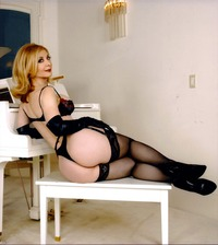 mature porn star babe nina hartley white nude round ass stockings heels