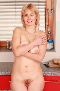 mature redhead porn redhead porn nella mature age stripping kitchen photo