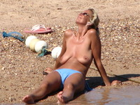 mature series porn voyeur porn topless blonde saggy beach mature photo