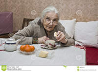 old lady porn old lady european drinking tea home watering viola flower