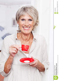old picture porn woman vivacious older woman drinking espresso coffee modern small red cup standing indoors smiling viewer royalty free stock happy old using