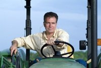 big pics mature handsome mature white male sitting comfortably green tractor smiling contentedly confid photo