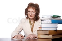 big pics mature preview mature woman sitting table books