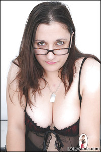 busty mature images pics busty mature gal glasses takes off peignoir rips pantyhose