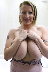 busty milf pics galleries silicone laura busty milf showering showers