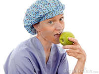 granny pics nurse medical person eating granny smith apple stock photography