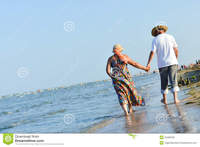 mature beach porn pictures sea walk happy mature couple seashore sandy beach holding hands walking embracing summer outdoors background walks