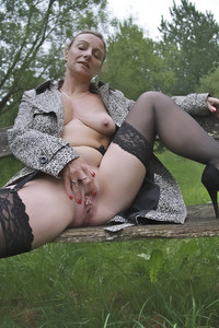 mature blonde porn pics amateur porn upskirt mature blonde nude field showing shaved pussy photo