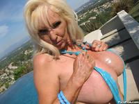 mature breasts porn tits porn mature whore sunning silicone pumped breasts photo