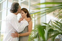 mature close up depositphotos close mature couple kissing home standing large glass doors stock photo