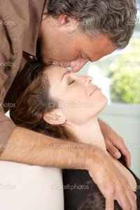 mature close up depositphotos close mature man kissing womans forehead lounging homes living room stock photo