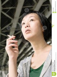 mature close up woman smoking closeup portrait mature asian under bridge city daytime royalty free stock photography
