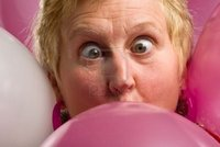 mature close up markfgd close mature woman face surrounded pink balloons photo