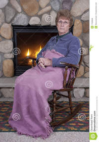 mature face pics mature senior woman sad face rocking chair fire royalty free stock photos