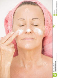 mature face pics woman putting cream face portrait attractive relaxed mature moisturizing smiling lotion finger cheek towel royalty free stock photography