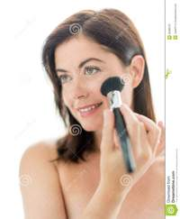 mature face pics attractive woman applying makeup face portrait beautiful mature lady forties using professional brush apply powder royalty free stock photography