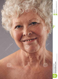 mature face pics attractive senior woman face sweet smile headshot against grey background positive mature stock photo