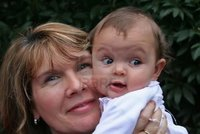 mature girl on girl bluewren mature woman holding six month old baby girl cheek photo