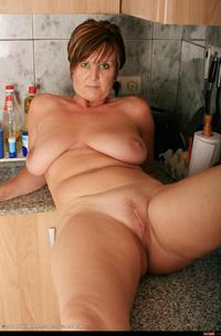 mature housewives photos wmimg apron kitchen mature over shaved solo bbw