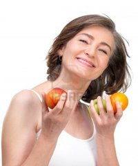 mature image logos mature woman holding fruit against white background photo
