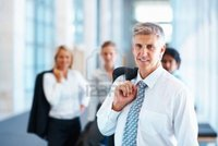 mature image logos happy mature business man his associates background photo