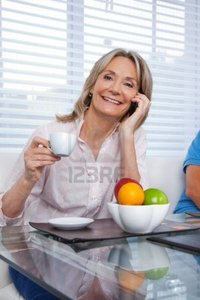 mature image leaf portrait mature woman talking cell phone having cup tea photo