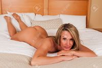 mature nudes disorderly beautiful mature blonde lying nude bed stock photo