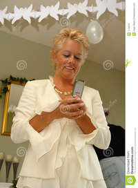 mature photos mature lady party sending sms stock photo