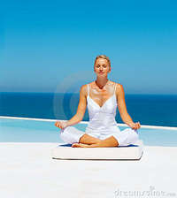 mature photos mature woman meditating sea shore royalty free stock photo