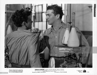 mature pictures gallery photos victor mature grasping shoulder man scene from film picture detail news photo