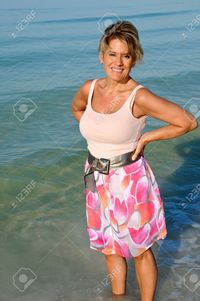 mature sexy eyemark attractive woman standing ocean surf stock photo mature fifty