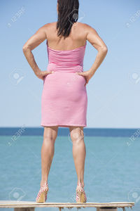 mature sexy roboriginal portrait beautiful mature woman standing leisure sexy pose table ocean wearing red summer stock photo