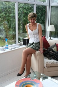 mature upskirt porn mature blonde housework plaid miniskirt