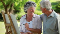 mature wife pic shutterstock videos video clip stock footage smiling mature man looking his wife who painting countryside
