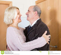 mature wife pic mature wife meeting husband near door happy senior women hugging elderly boyfriend doorway smiling stock photo